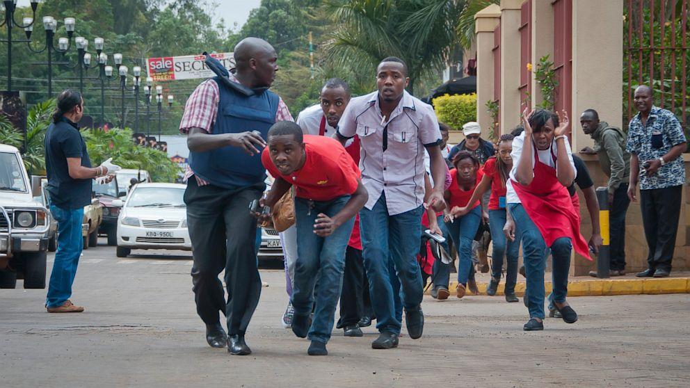 Survivors fleeing the scene