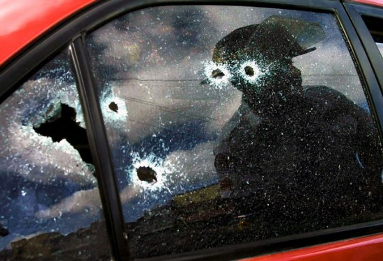 A car smashed with bullet shells