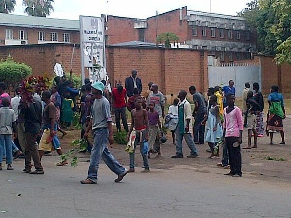 Demonstrators tear down MEC HQ signpost protesting that Blantyre Girls polling centre got 2009 ballot papers